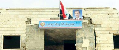 Photo of العلم الوطني يرتفع مجدّداً فوق مبنى مدرسة الشرطة في خان العسل